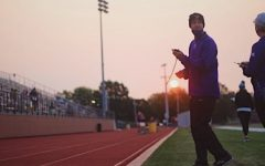 Assistant Cross Country coach Johnson takes times for his athletes at the Kirksville virtual meet September 19th