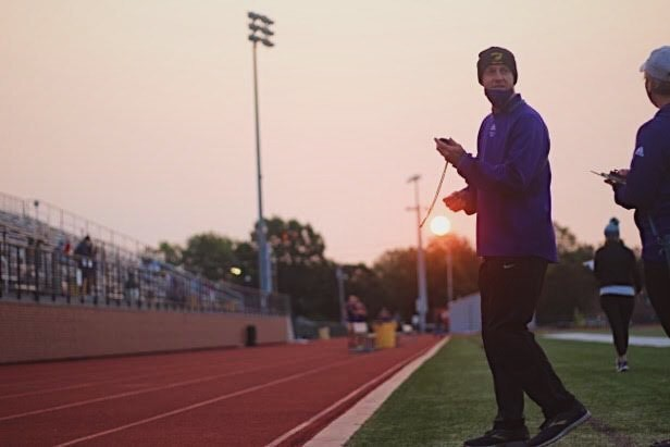 Assistant+Cross+Country+coach+Johnson+takes+times+for+his+athletes+at+the+Kirksville+virtual+meet+September+19th
