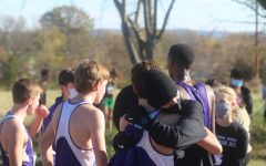 Elliot Muhlenbruck (23) embraces teammate Evan Hughes (23) after the team found out they made it to state.